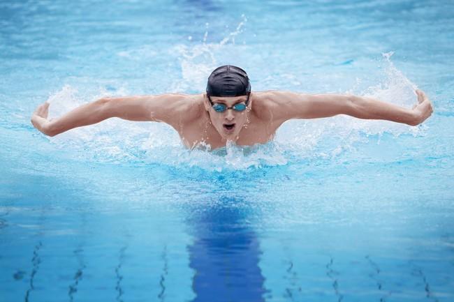 Stock photo of swimmer in cap.