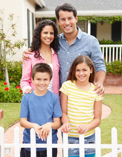 Hispanic Family Outside Home Photo ©MonkeyBusinessImages
