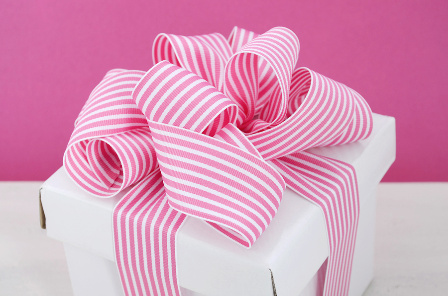 White gift box with pink stripe ribbon by Milleflore Images