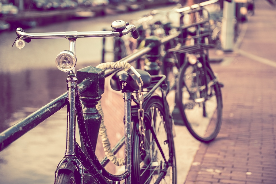 Image of secured old bikes in Amsterdam |by ginton    Pit stop. (Just a friendly reminder to lock up your bike, of course. Besides, we just really love this photo.)