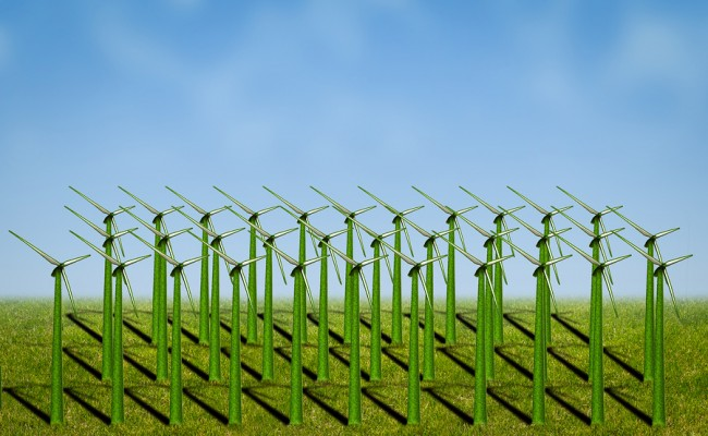 photo of wind turbines covered with grass in a field