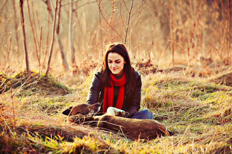Stock photo of woman and her dog.