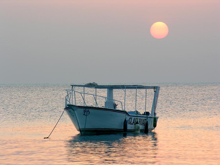 bigstock_Boat_At_Sunrise_433161