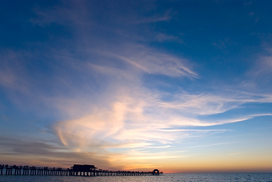 Image of a sunset on the pier, Naples by MONIPHOTO