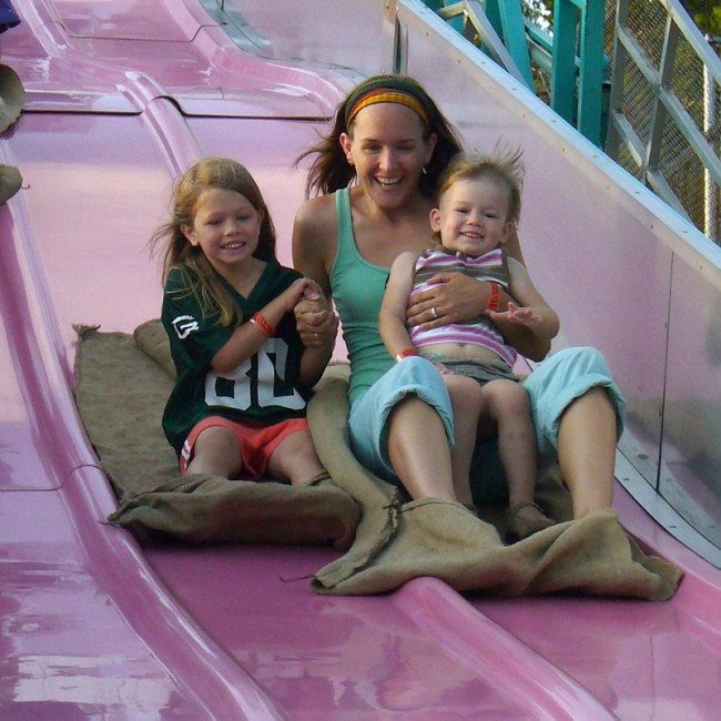 Image of Janice and children on slide.