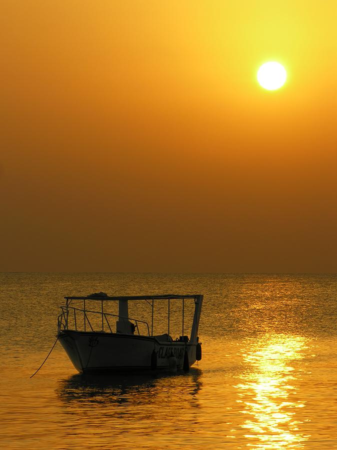 bigstock_Boat_At_Sunrise_433163