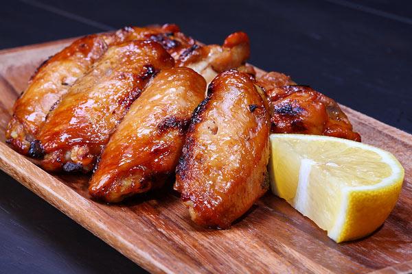 Grilled Chicken Wings Served On Wooden Board Image ©zanskar